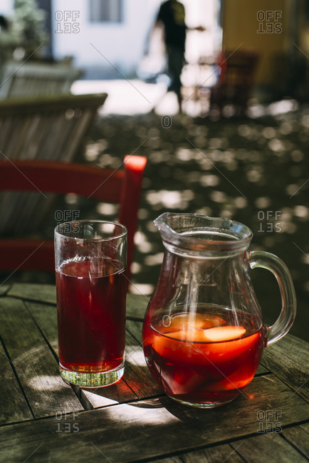 Ice tea in jug and glass outdoors