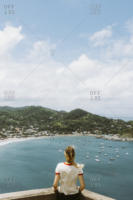 Rear view of woman looking at bay