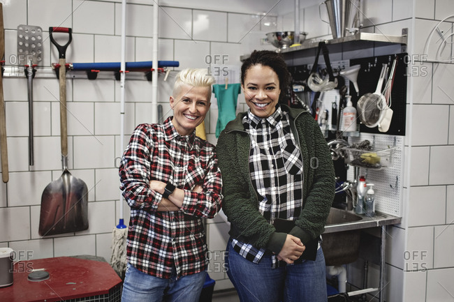 Portrait of smiling female workers standing in brewery