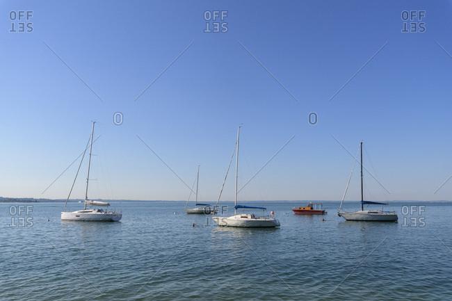 Garda, Veneto, Italy - August 13, 2016: Sailboats anchored on Lake Garda (Lago di Garda) on a sunny day