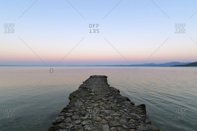 Angler jetty on Lake Garda (Lago di Garda) at dawn in Garda in Veneto, Italy