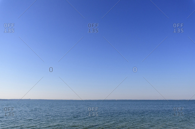 Lake Garda (Lago di Garda) and blue sky on a sunny day in summer at Garda in Veneto, Italy