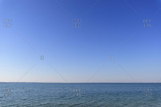 Lake Garda (Lago di Garda) and blue sky on a sunny day in summer at Garda in Veneto, Italy