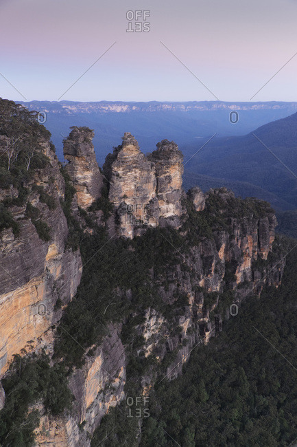 Three Sisters rock formation at sunset in the Blue Mountains National Park in New South Wales, Australia