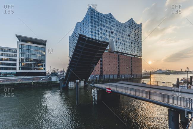 February 20, 2018: Germany- Hamburg- opened bridge Am Kaiserkai- Elbe Philharmonic Hall at sunset