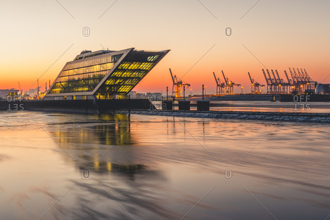 March 2, 2018: Germany- Hamburg- Dockland- modern office building at sunrise