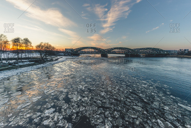 March 1, 2018: Germany- Hamburg- Freihafenelbbruecke- Elbe river and ice at sunset