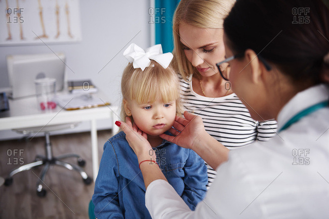 Doctor examining girl in medical practice