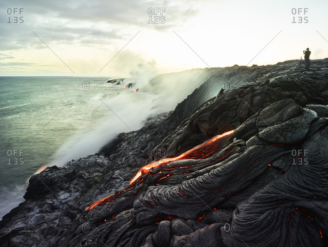 Hawaii- Big Island- Hawai'i Volcanoes National Park- lava flowing into pacific ocean- photographer
