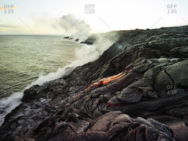 Hawaii- Big Island- Hawai'i Volcanoes National Park- lava flowing into pacfic ocean