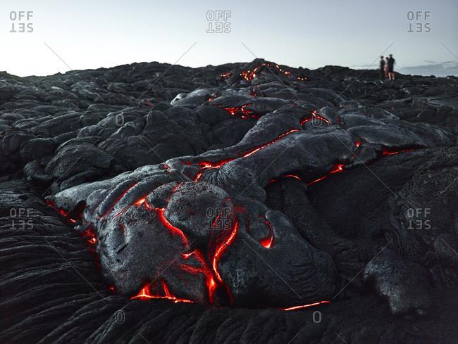 Hawaii- Big Island- Hawai'i Volcanoes National Park- tourists standing on lava field