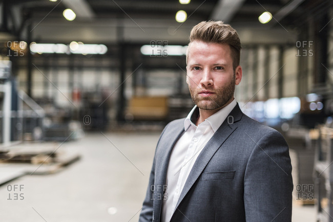 Portrait of confident businessman on factory shop floor