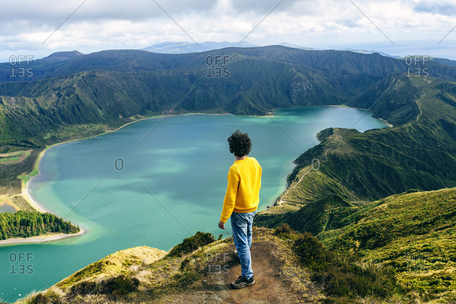Azores- Sao Miguel- rear view of man looking at the Lagoa do Fogo