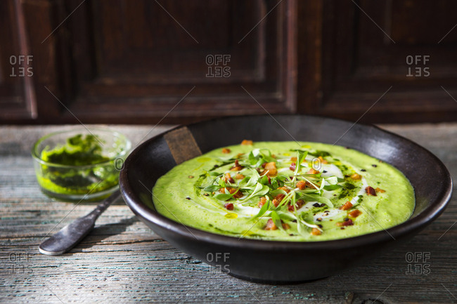 Cream of avocado soup with bacon and mint pesto