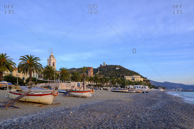 Italy- Liguria- Riviera di Ponente- Noli- fishing boats at beach in the morning light