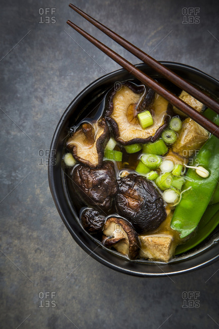 Japanese miso soup with sugar peas- shitake mushrooms- tofu and mung sprouts