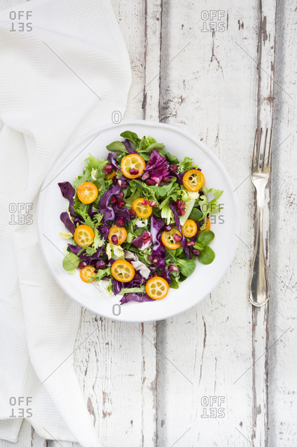 Mixed salad with kumquat- red cabbage and pomegranate seeds