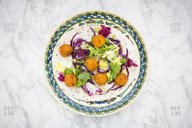 Falafel- wrap- salad- red and white cabbage- yogurt sauce