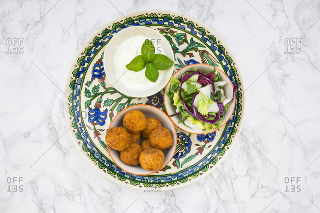Falafel- salad- red and white cabbage- yogurt sauce with mint