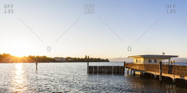 Germany- Baden-Wuerttemberg- Langenargen- Lake Constance- shipping pier at sunrise