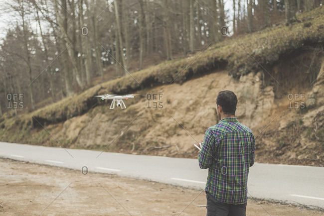 Man flying a quadcopter drone