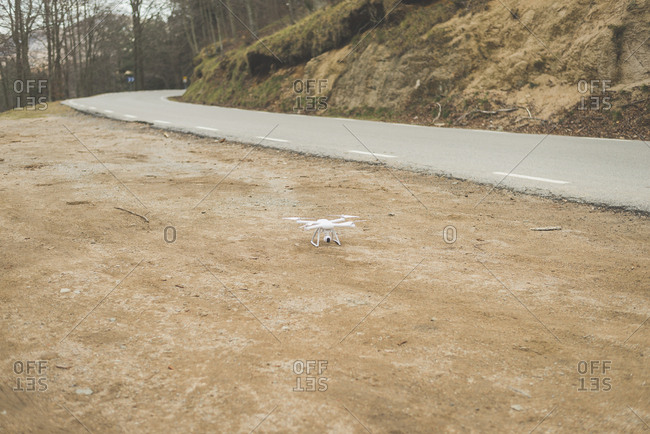 A quadcopter drone on the side of a highway
