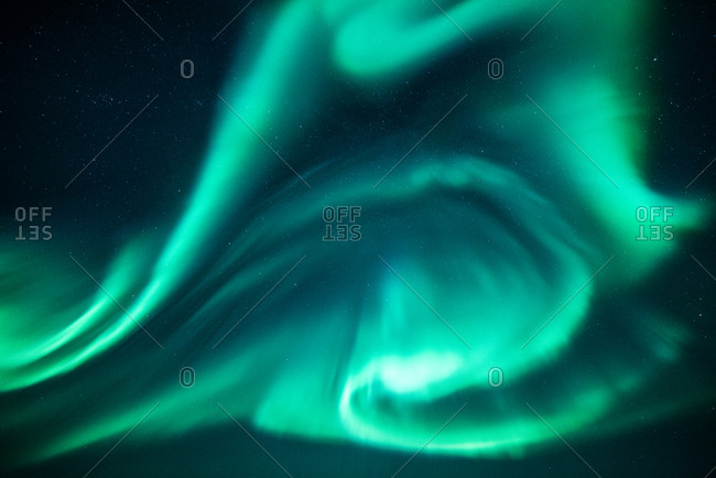 Northern lights glowing brightly in the night sky