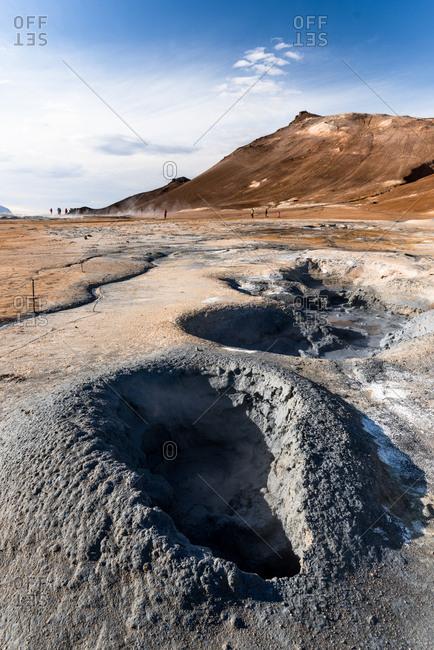 Geothermal formations in barren landscape
