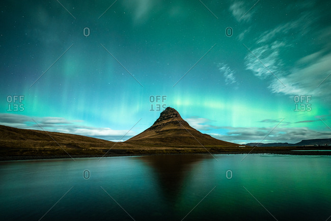 Aurora borealis over mountain and water