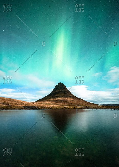 Northern lights over mountain and water