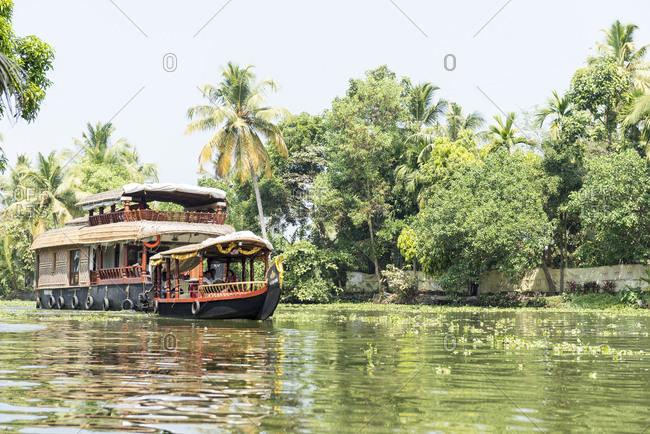 Kerala, India - August 24, 2012: House boat and tour boat in the Kerala Backwaters, Kerala, India