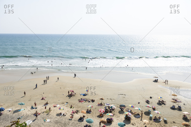 Kerala, India - September 8, 2012: Tourists on Varkala Beach, Kerala, India