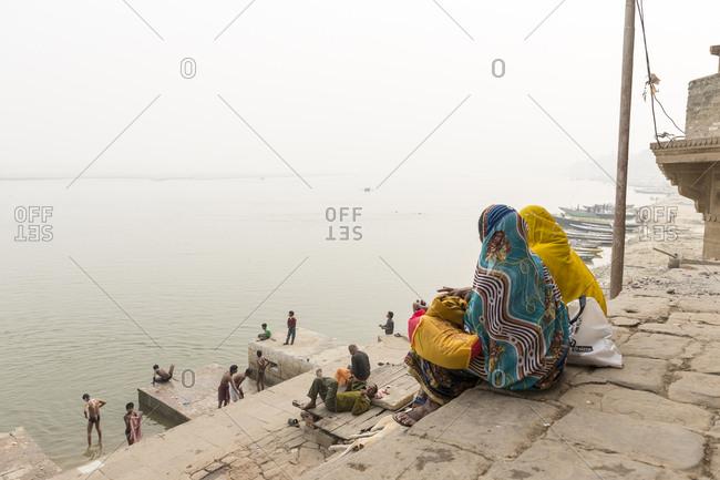 Varanasi, India - June 20, 2012: People overlooking River Ganges, Varanasi, India