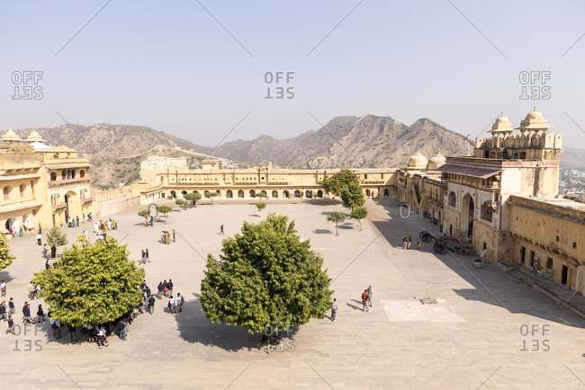Jaipur, India - 30 June, 2012: Elevated view of visitors in courtyard of Amber Fort