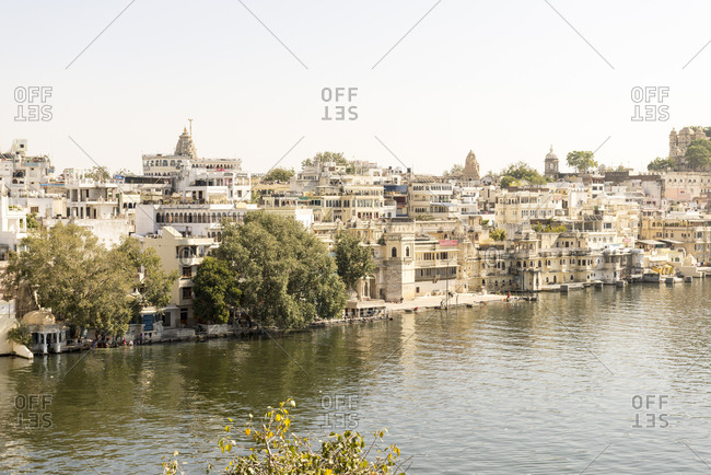 Udaipur, India - 4 July, 2012: Looking across Lake Pichola at densely packed buildings on waterfront