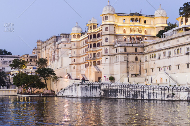 Udaipur, India - 7 July, 2012: View of the City Palace at dusk from Lake Pichola