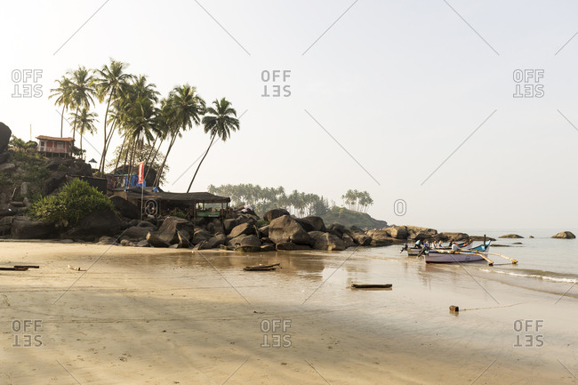 Goa, India - 28 July, 2012: Tourists on a local boat on the idyllic Palolem Beach