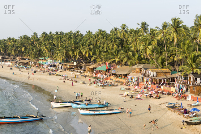 Goa, India - 29 July, 2012: Aerial view of tourists and locals on the beach at Palolem