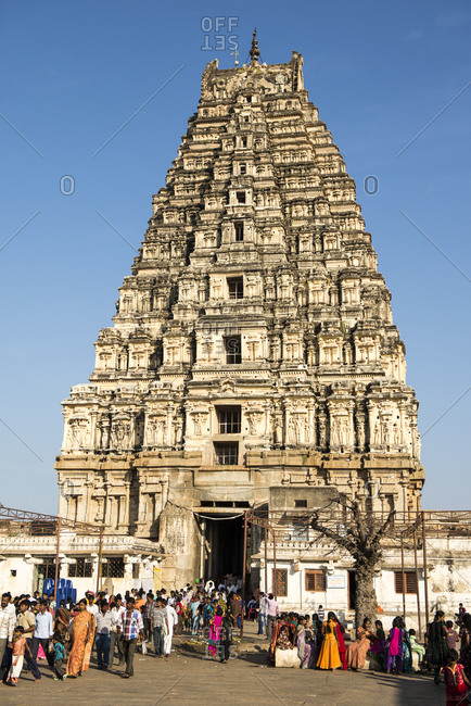Hampi, India - 06 August, 2012: Visitors throng the entrance of the temple dedicated to the god Virupaksha