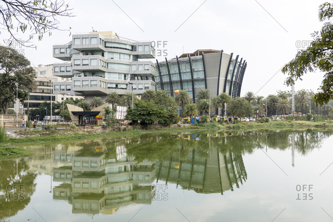 Bangalore, India - 08 August, 2012: Modern office building complex reflected in still waters of lake