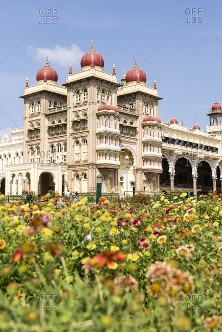 Mysore, Karnataka, India - 11 August, 2012: View over flowerbeds of the royal residence of Mysore Palace