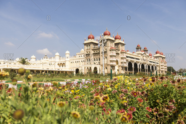 Mysore, Karnataka, India - 11 August, 2012: View over flowerbeds of the magnificent Mysore Palace