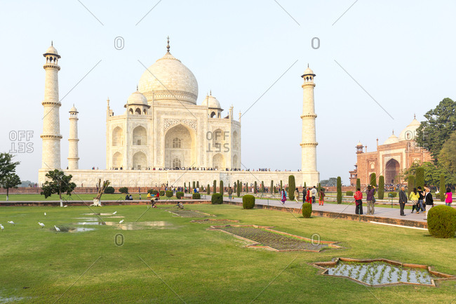 Agra, India - 25 June, 2012: Visitors throng the iconic Taj Mahal