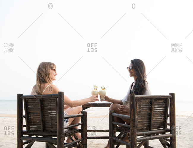Women drinking cocktails in a resort near to the beach