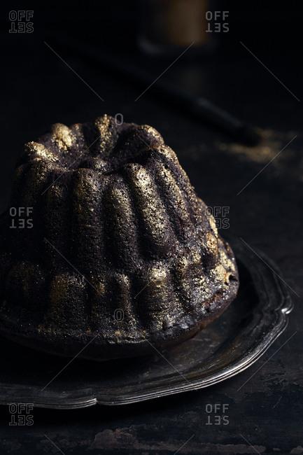 Mini chocolate bundt cake decorated with golden glitter