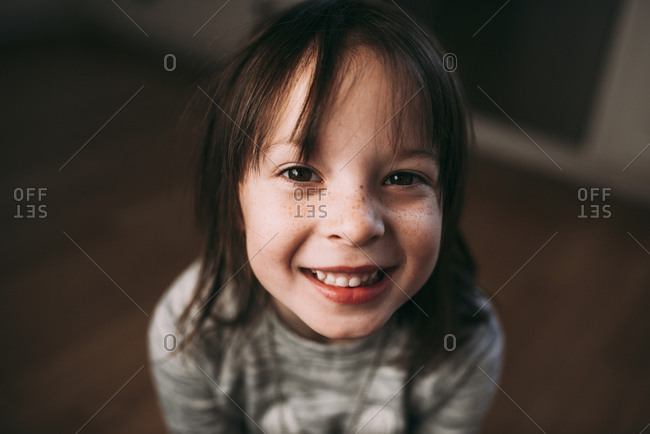 Portrait of a little girl with dark hair and freckles