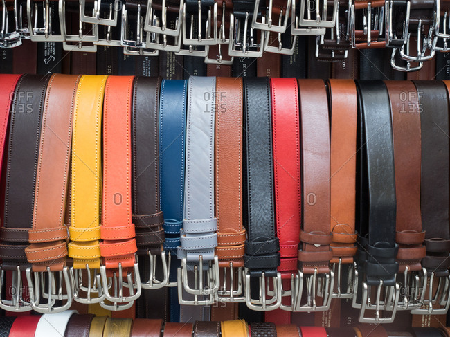 Display of colorful handmade leather belts