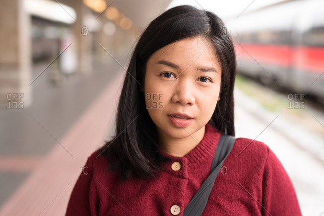 Portrait of an Asian young woman wearing a red sweater