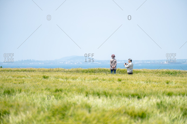 Jejune Island, Korea - April 27, 2018: Tourists in a field