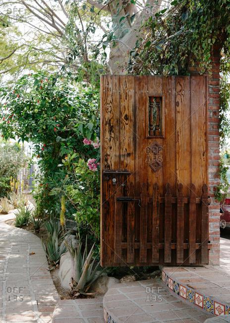 Wooden door at the entrance to a boutique hotel in Todos Santos, Mexico